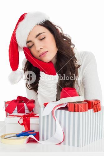 Brown hair in santa hat napping