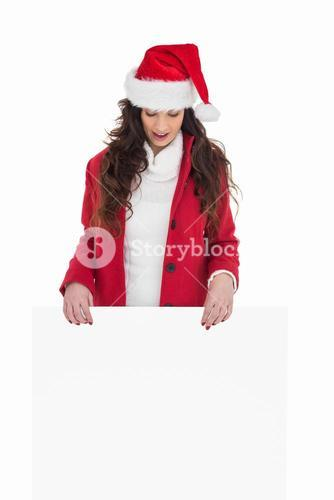 Festive brunette showing white poster