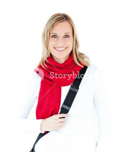 Portrait of a delighted student with scarf smiling at the camera