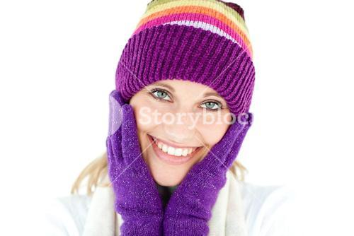 Radiant young woman with cap and gloves in the winter