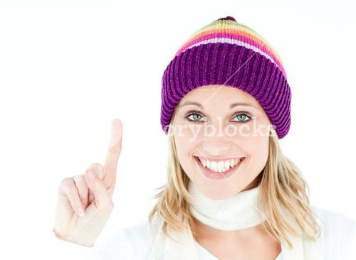 Positive woman showing up smiling at the camera against white background