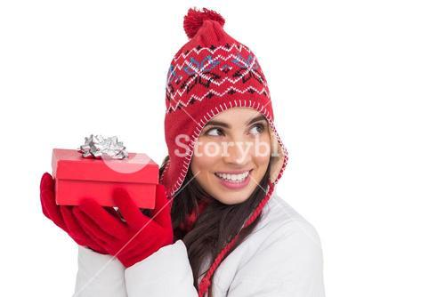 Happy brown hair holding red gift