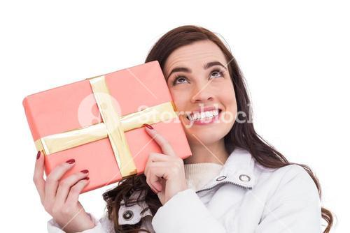 Portrait of a happy brunette holding gift