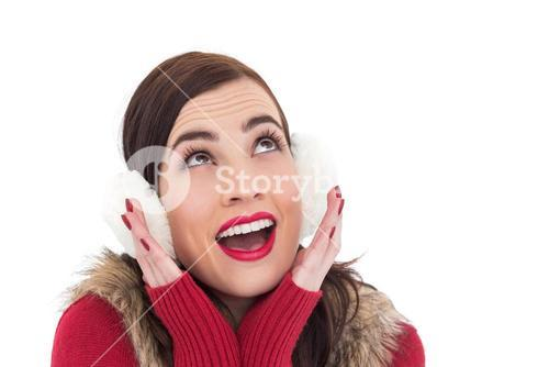 Surprised brunette in winter clothes