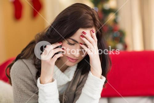 Concentrated brunette on the phone on christmas day