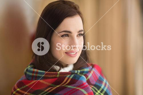 Portrait of a pretty brunette with cover