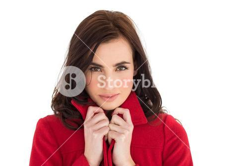 Portrait of a pretty brunette in red coat