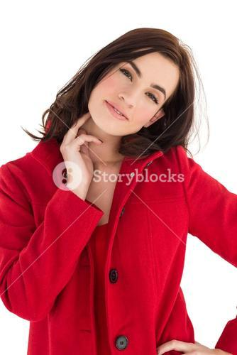Portrait of a cheerful brunette in red coat