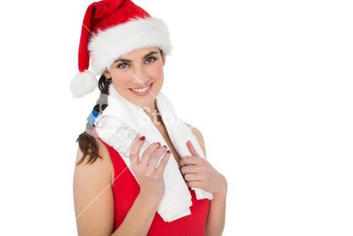 Festive fit brunette smiling at camera