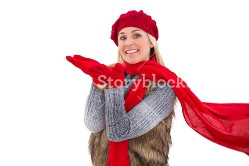 Blonde in winter clothes with hands out
