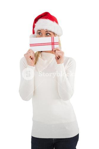 Festive blonde holding a gift