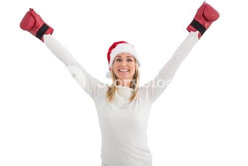 Festive blonde in boxing gloves