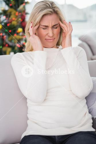 Blonde getting a headache on christmas day