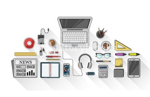 Overhead of desk with stationery and technology