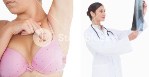 Woman performing self breast examination