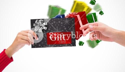 Composite image of hands holding card