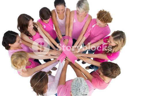 Composite image of cheerful women joined in a circle wearing pink for breast cancer