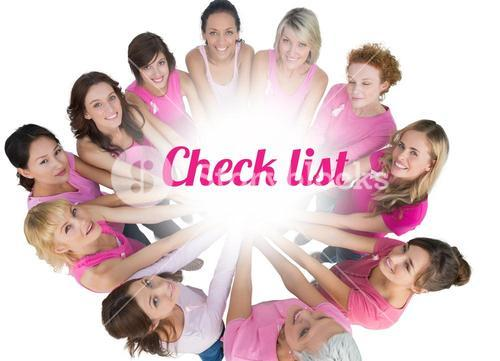 Cheerful women joined in a circle and looking up at camerawearing pink for breast cancer
