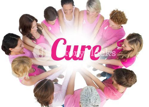 Cheerful women joined in a circle wearing pink for breast cancer