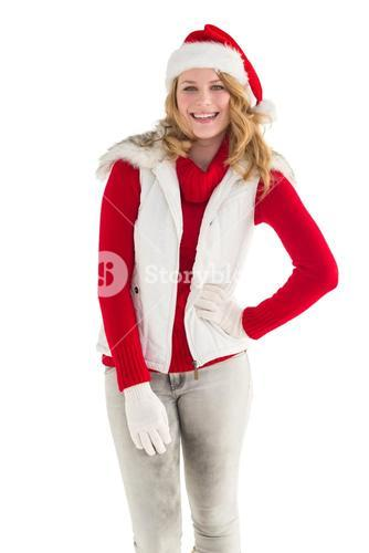 Smiling pretty blonde standing in warm clothes