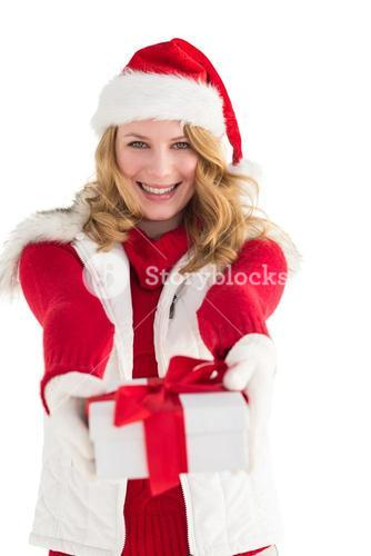 Festive blonde giving red gift