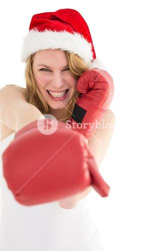 Festive blonde punching with boxing gloves