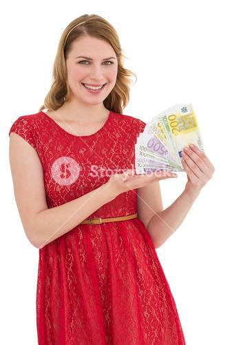 Pretty blonde in red dress showing her cash