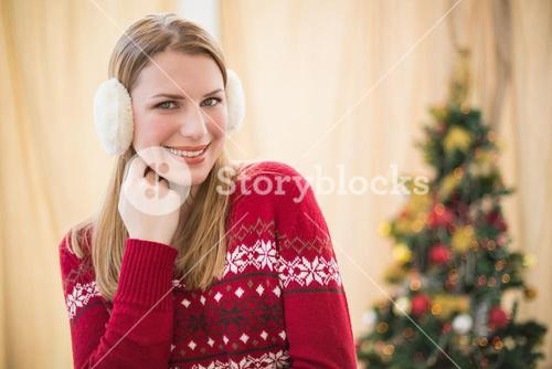 Portrait of a pretty smiling blonde wearing earmuffs