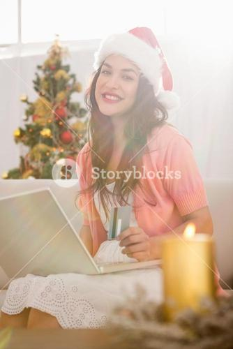 Festive brown hair shopping online with laptop at christmas