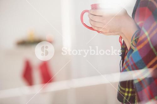 Woman with cover holding mug