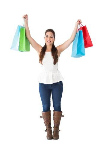 Brunette in casual clothes holding shopping bags