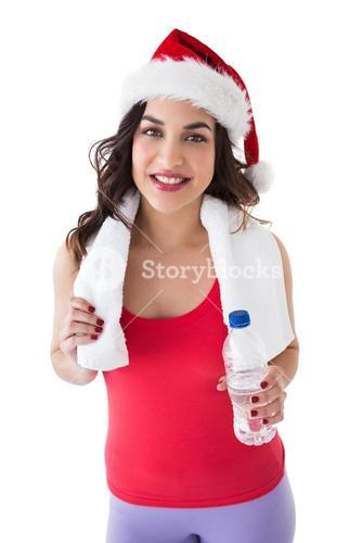 Festive fit brunette holding bottle