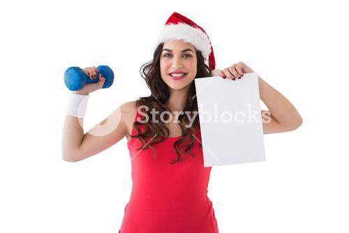 Festive fit brunette showing page and dumbbell
