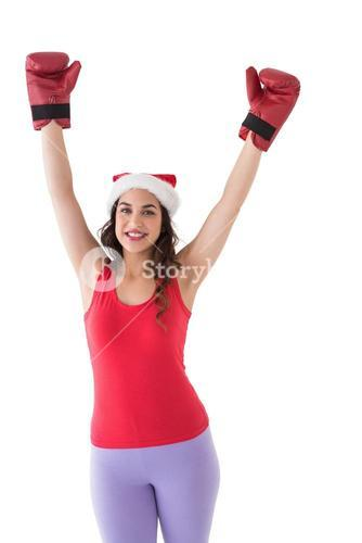 Festive brunette in boxing gloves cheering