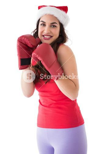Festive brunette in boxing gloves