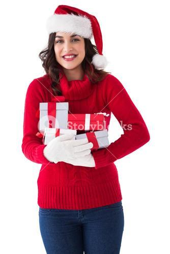 Festive brunette in winter clothes holding gifts