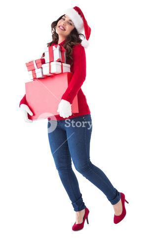 Happy brunette holding many gifts