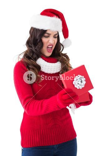 Disappointed brunette opening christmas gift