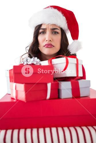 Confused brunette holding pile of gifts