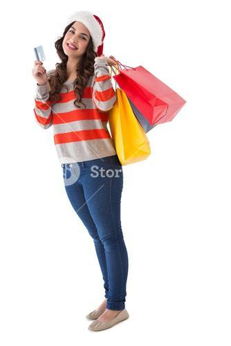 Happy brunette holding shopping bags and credit card