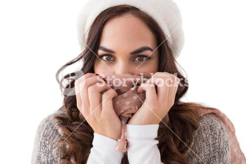 Brunette in winter clothes holding her scarf