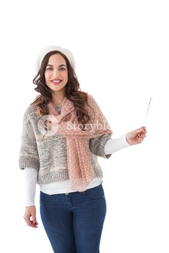Brunette in winter clothes holding