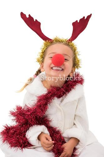 Cute little girl wearing red nose and tinsel