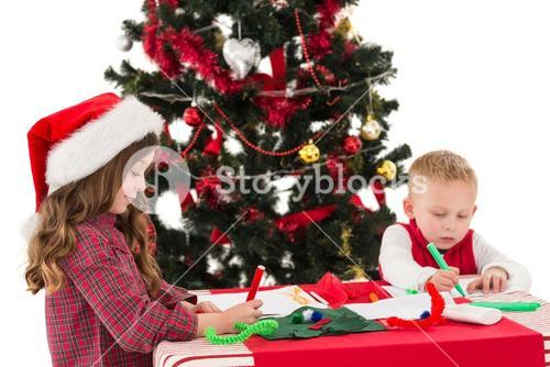 Festive little siblings drawing pictures