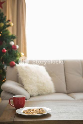 Cookies and mug on coffee table at christmas