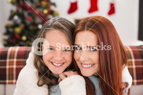 Festive mother and daughter on the couch