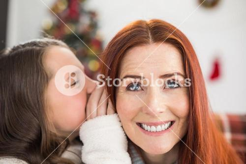 Daughter telling her mother a christmas secret