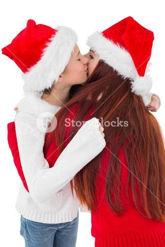 Festive mother giving daughter a hug