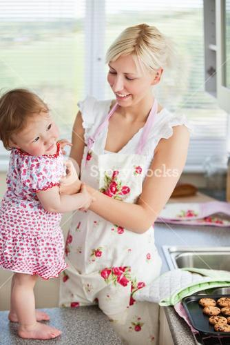 Beautiful mother baking with her daughter together