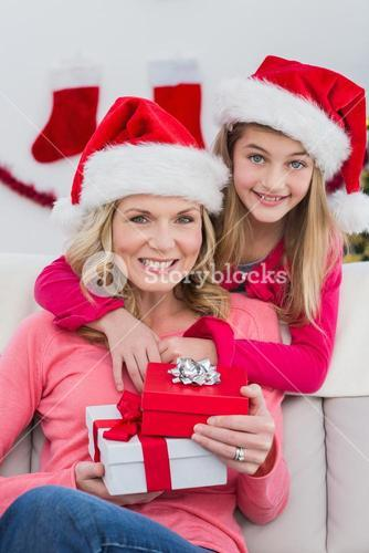 Festive mother and daughter with gifts